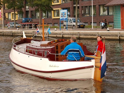 Sailing with a traditional flat bottomed motor yacht