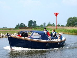 With a half open sloop along the Frisian Eleven Towns